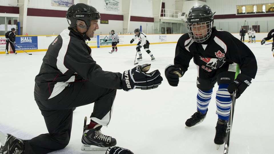 coach high fiving kid