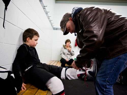 dad tying skates