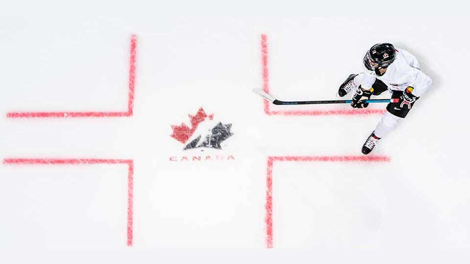 player on ice with logo